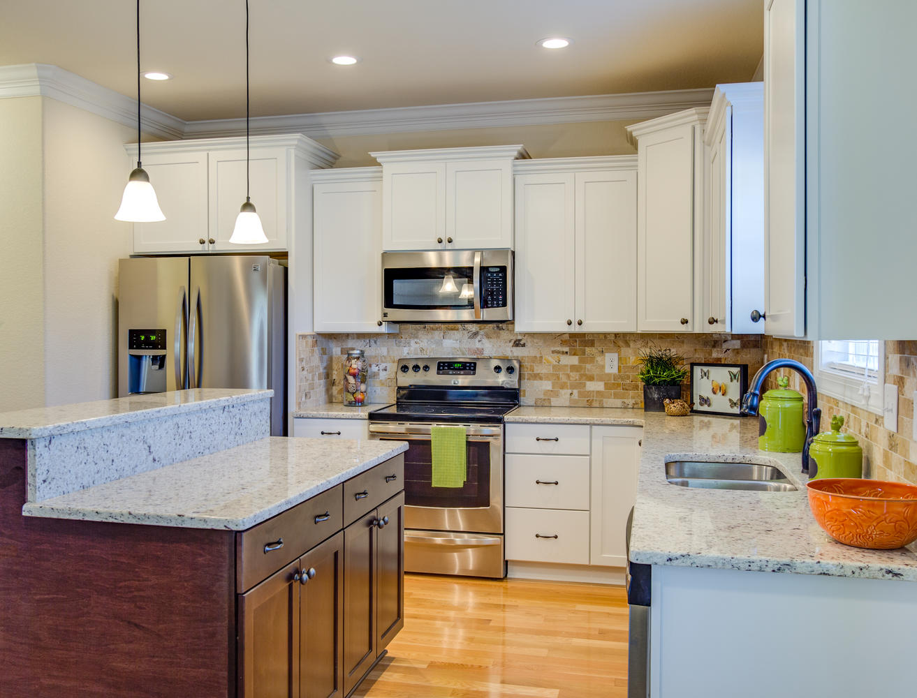 The August model beautiful kitchen with granite and stainless steel appliances AB Homes