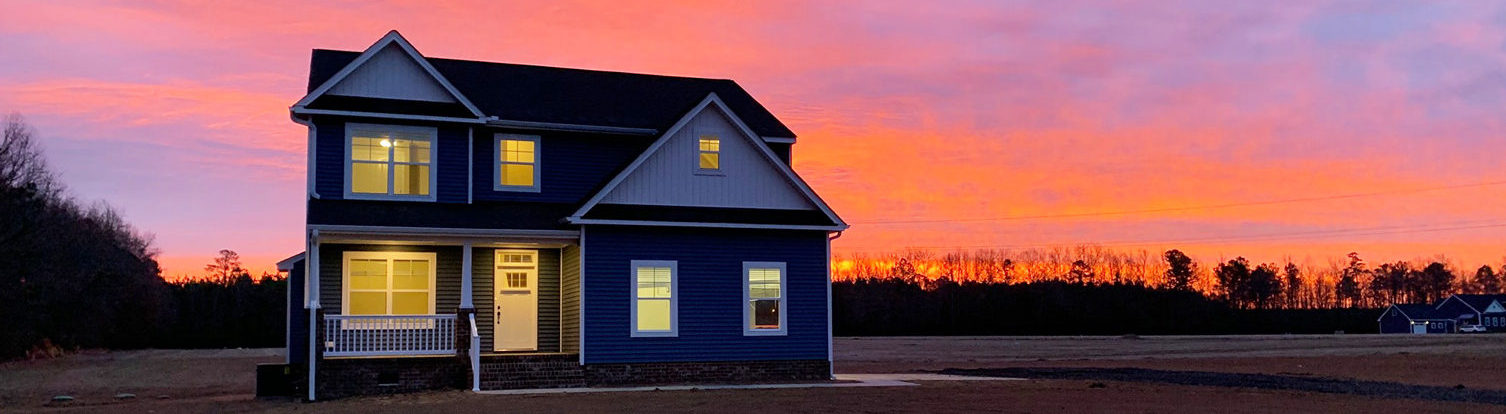Ab Homes new home at sunset