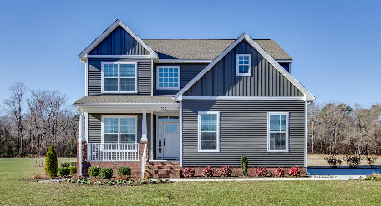 The Augusta Floor Plan By AB Homes With Dark Tan Siding, White Trim And Landscaping