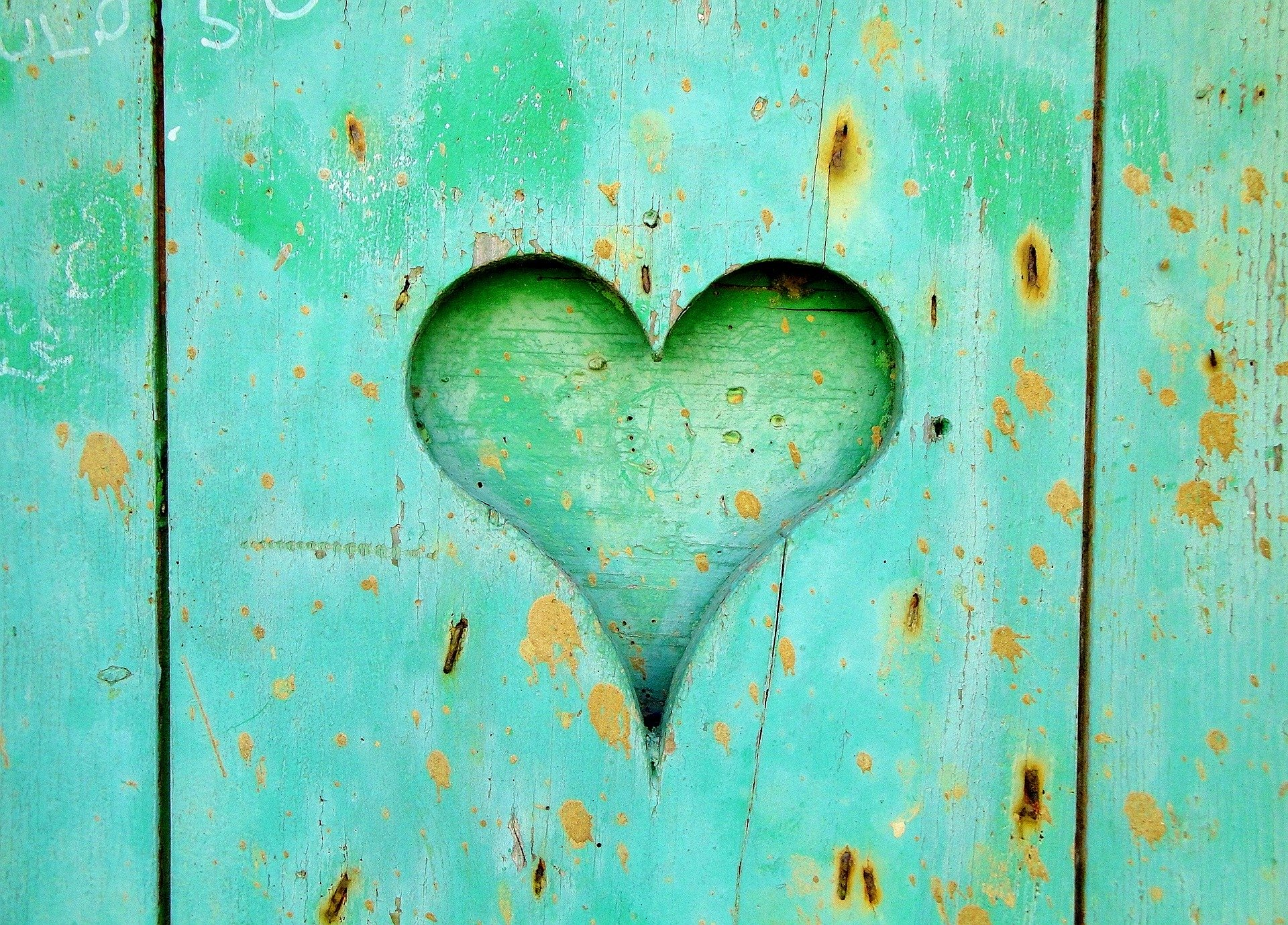 Green wooden board with a heart cut out