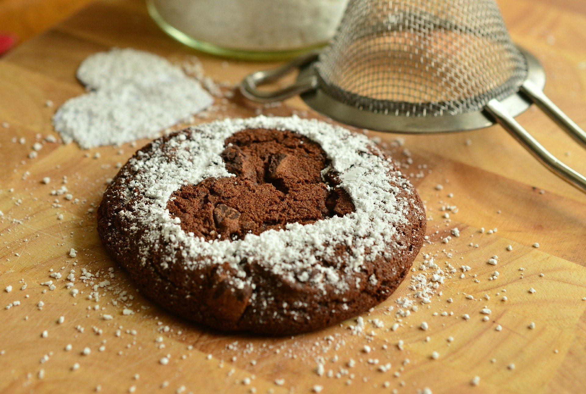 Chocolate Cookie With White Sugar Powder With The Shape Of A Heart