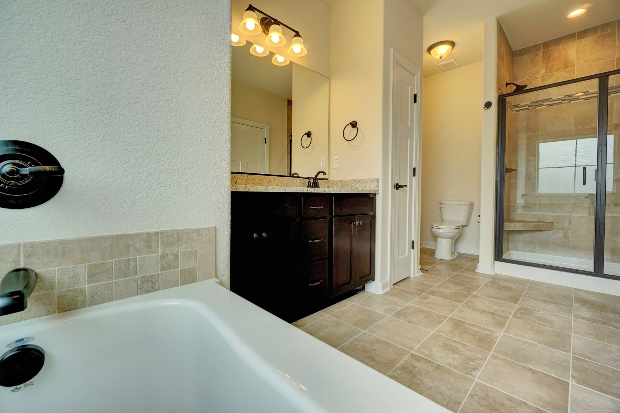 AB Homes The Kitty Hawk floor plan master bathroom with double vanity, shower and tub