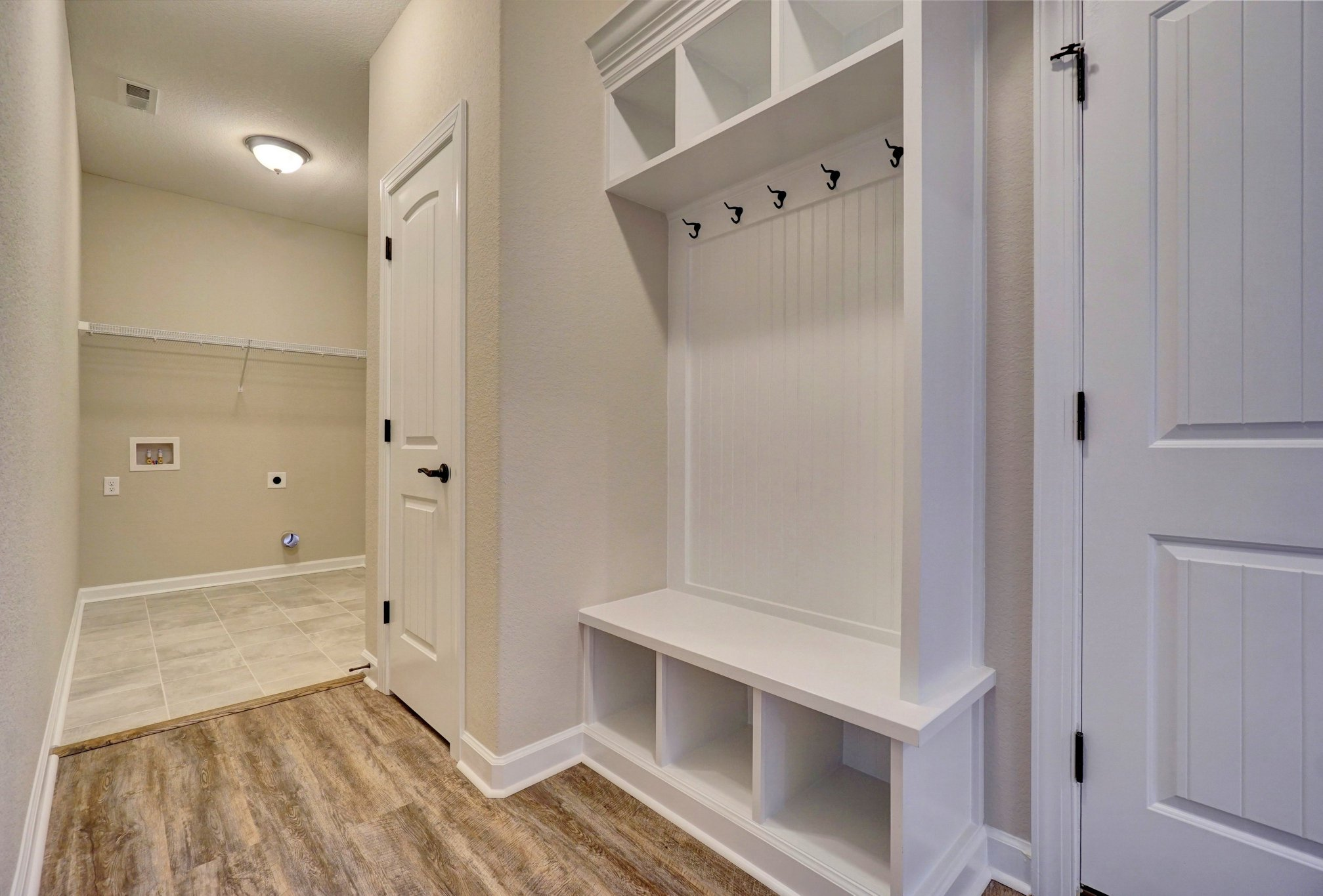 AB Homes The Springfield floor plan drop zone and laundry room