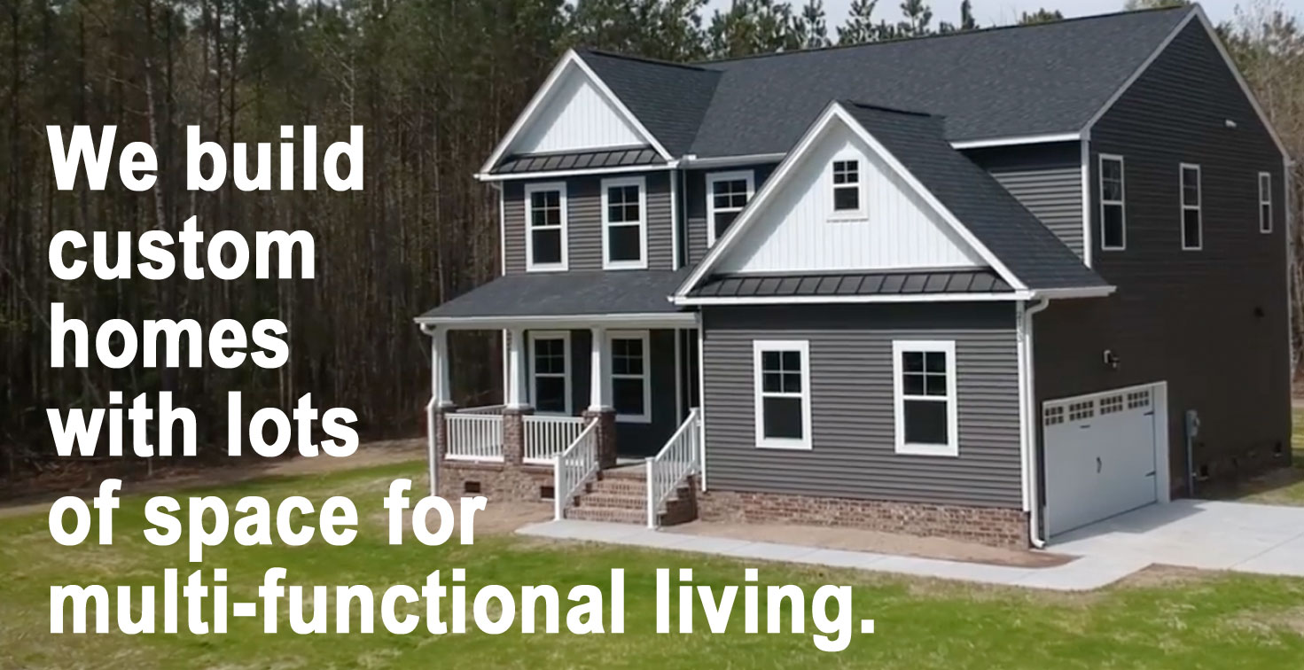 AB Homes The Augusta Floor Plan custom home with dark gray siding and white trim on a treed lot