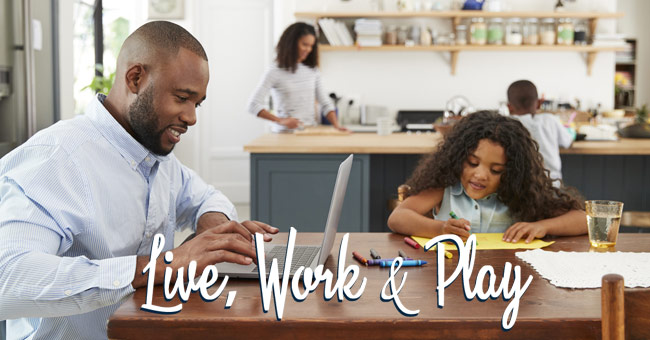 Family in the kitchen working, playing and cooking on the AB Homes blog Home as Your Base