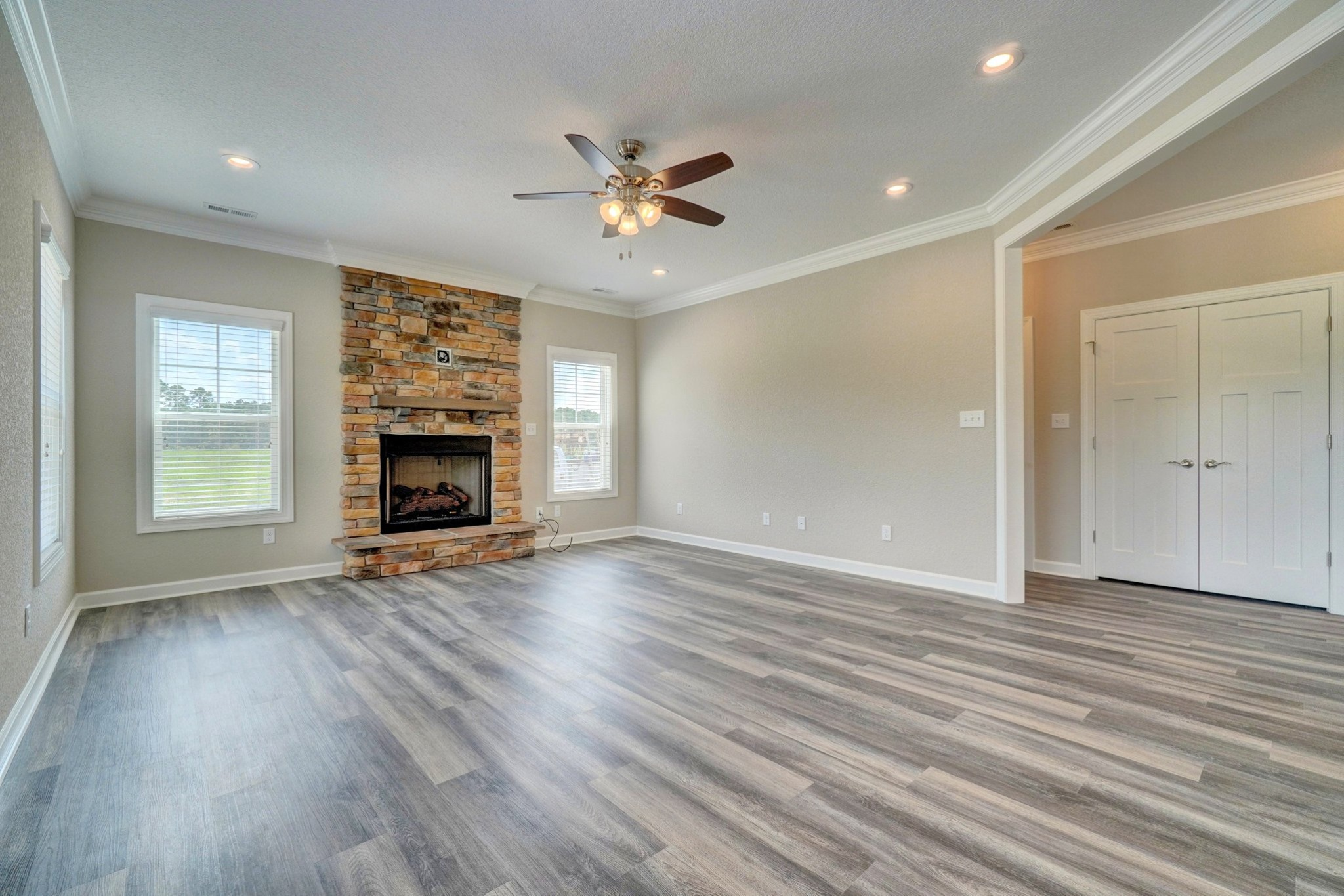 Stone fireplace in the AB Homes floor plan The Holland