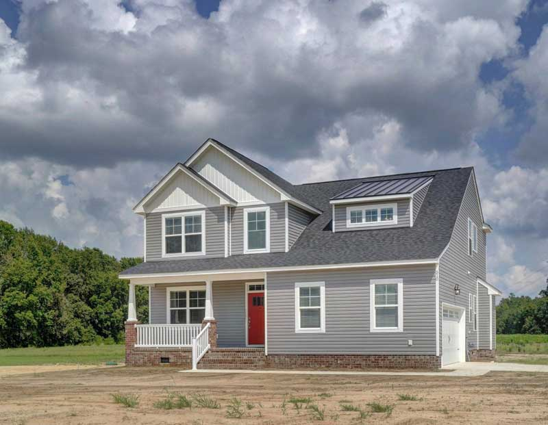 The Holland custom built home with a red door and large country style lot in Suffolk VA