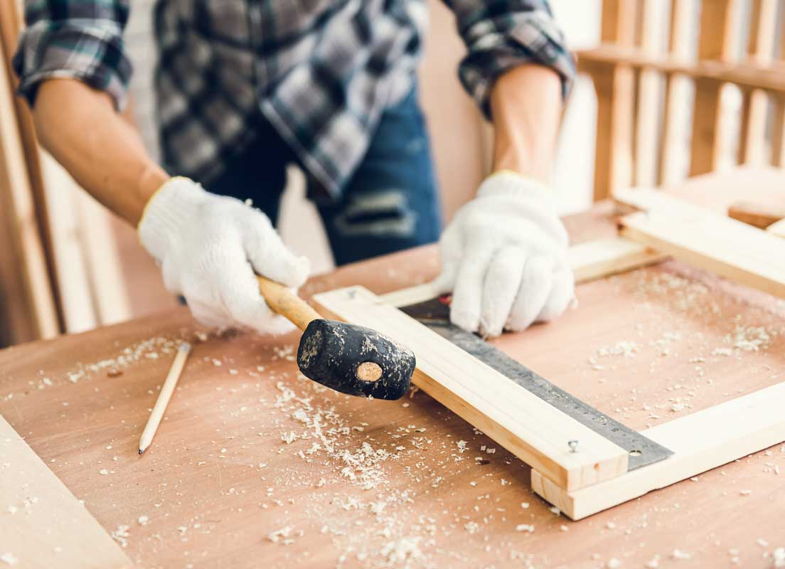 Home Builder Hiring Local With A Ruler And Hammer Working On A Custom Home